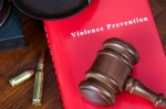 Violence prevention mopck book cover on a lawyer's desk.